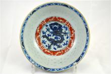 A blue, white and red bowl with Kangxi mark, doucai decoration. Early 20th