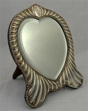 A silver, late Victorian heart shaped dressing table mirror. London 1896. H