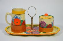 Three pieces of Clarice Cliff Bizarre 'Gayday,' comprising a sandwich plate