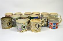 Fourteen Wedgwood commemorative mugs. (14)