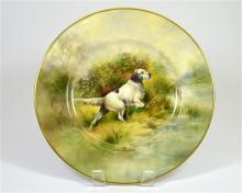 A bone china plate, hunting dog scene, signed R. Budd (a former Royal Worce