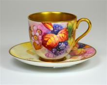 A Royal Worcester cup and saucer, with fruit decoration and gilded interior