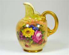 A Royal Worcester flatback jug with handle, with floral decoration and gild
