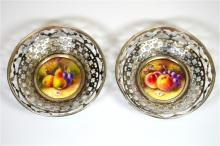 A pair of Royal Worcester silver mounted bon bon dishes, with fruit decorat