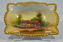 A Royal Worcester pin tray, titled Anne Hathaways Cottage, signed R. Rushto