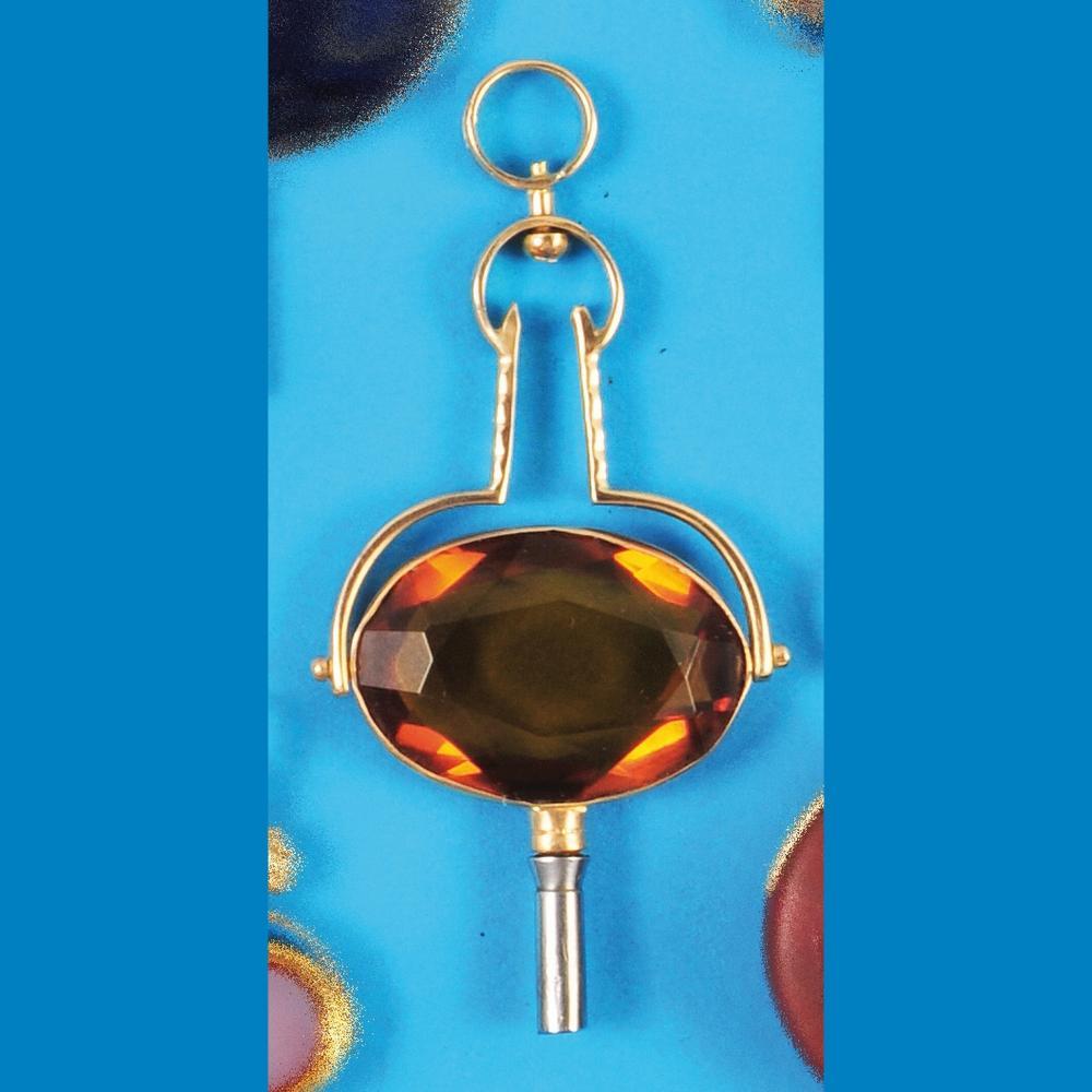 Golden pocket watch key