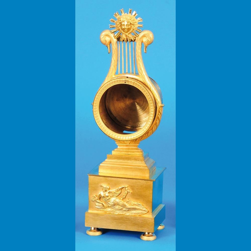 Clock case in lyra shape