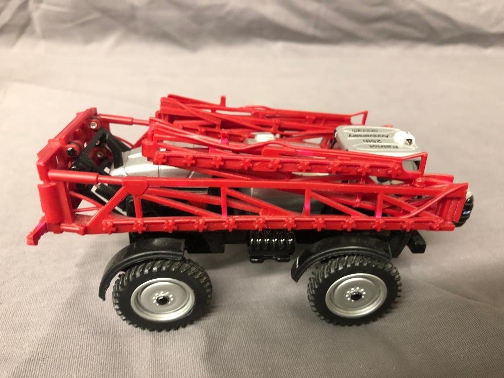 Lot 25: 1/64th Scale JD Semi w/ Tractors & Case IH Patriot