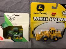 Lot 34: (2) 1/64th Scale John Deere Toys