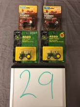 Lot 29: (4) 1/64th Scale JD & AC Tractors