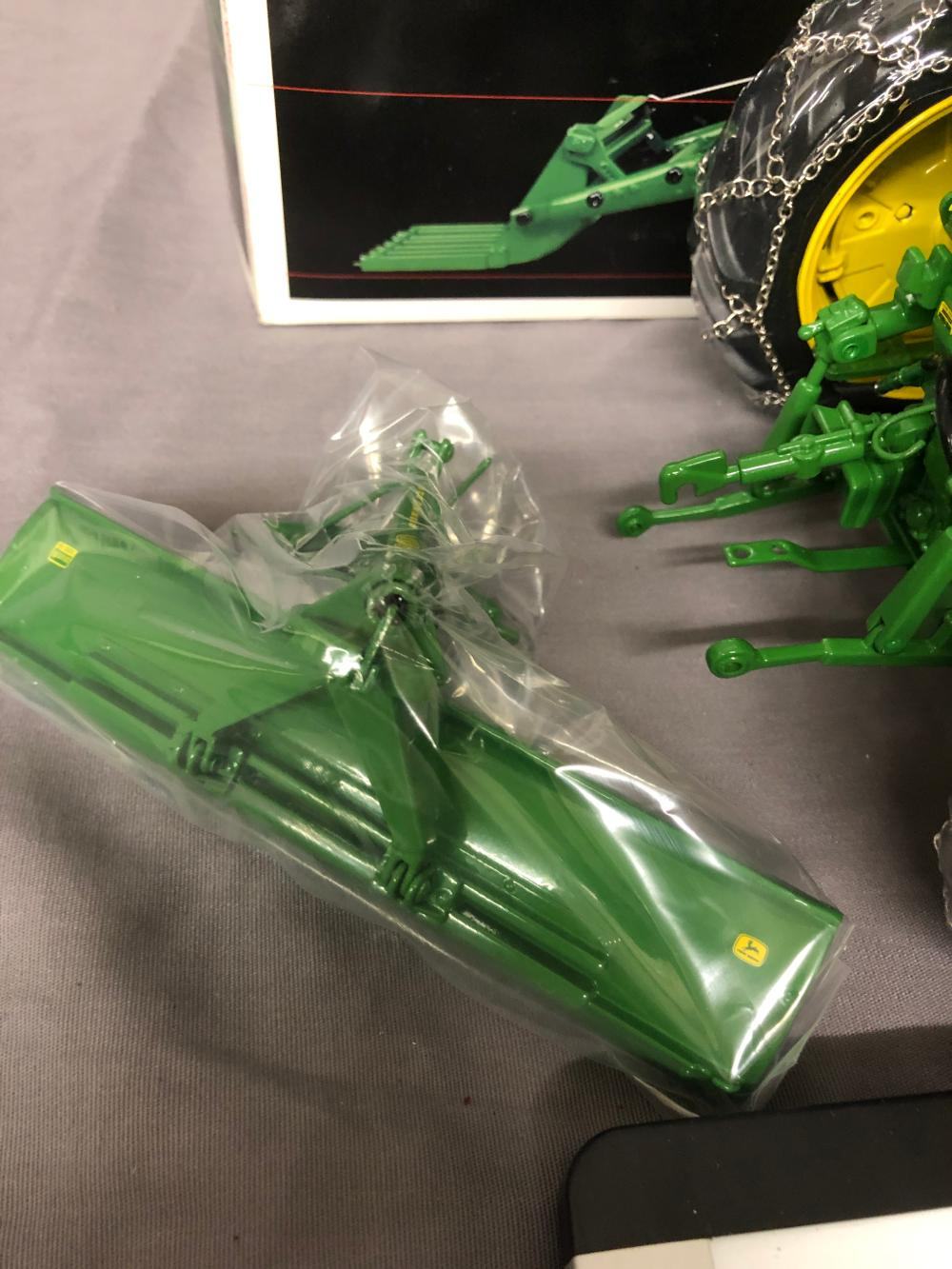 Lot 49: 1/16th scale Precision JD 720 w/ Blade & Loader