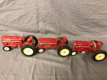 Lot 54: (3) 1/16th Scale International Tractors