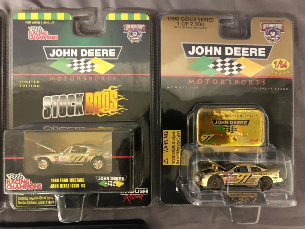 Lot 67: (4) 1/64th Scale John Deere Cars