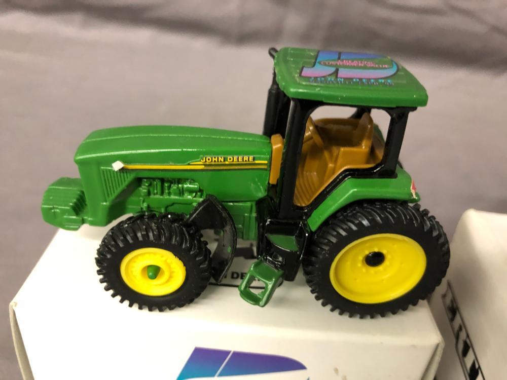 Lot 93: (7) 1/64th Scale John Deere Expo Tractors