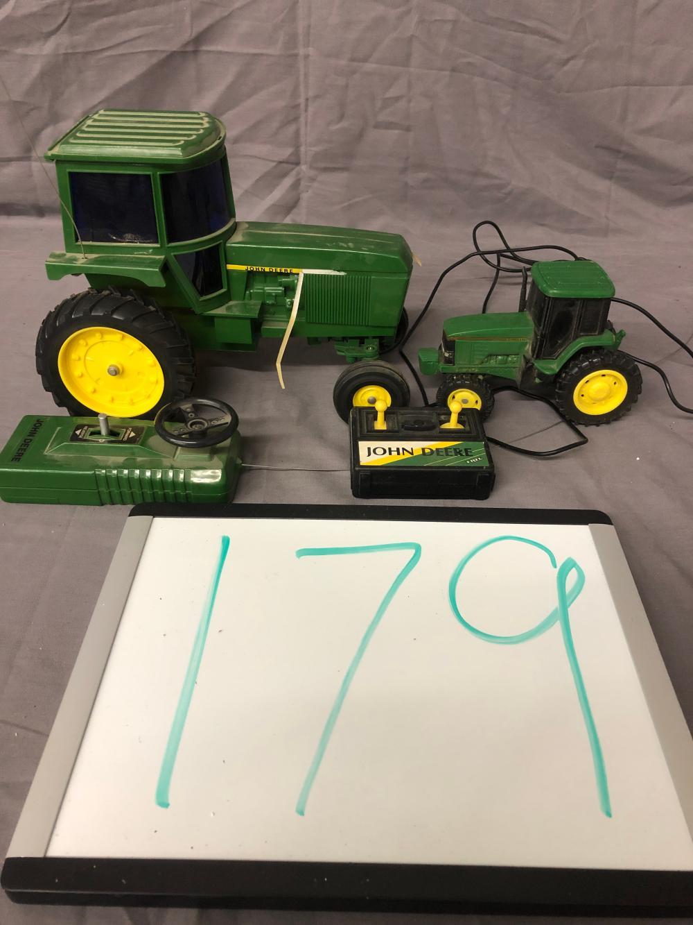 (2) Remote Control John Deere Tractors