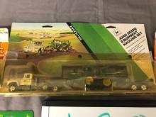 Lot 188: (4) 1/64th Scale JD, AC, & Ford Tractors