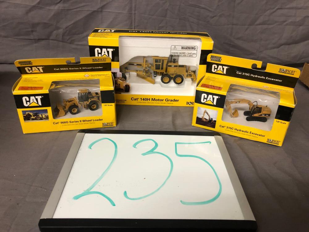 Lot 235: (3) Caterpillar Construction Toys