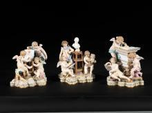 SUITE DE TROIS GROUPES ALLéGORIQUES ANIMéS D'AMOURS ILLUsTRANT LA PEINTURE, LA SCULPTURE ET L'ARCHITECTURE REPOSANT SUR DES SOCLES ROCAILLE   Allemagne, Meissen, XIXe siècle