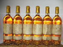 CHÂTEAU D'YQUEM <br> 2000 <br> 12 bouteilles <br> Étiquettes tachées* <br>
