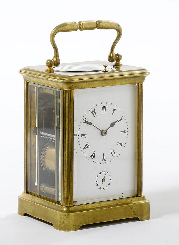 A TRAVELLING CLOCK, France, circa 1900. Brass and