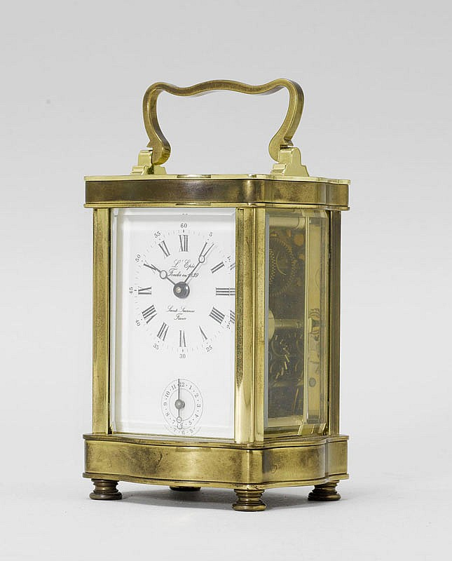 A TRAVELLING ALARM CLOCK, France, 20th c. The dial