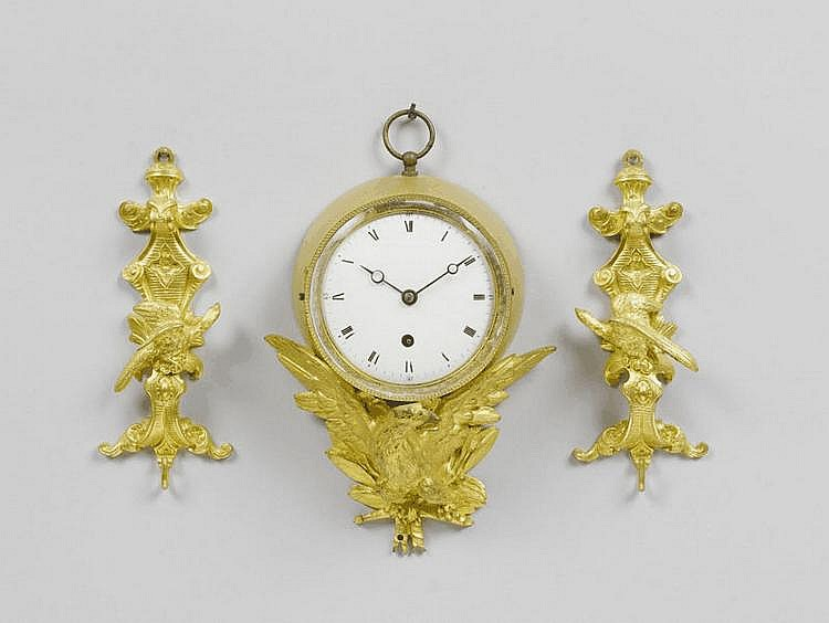 A SMALL GILT BRONZE CLOCK AND A PAIR OF APPLIQUES,