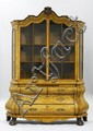 A RICHLY INLAID AND CARVED DISPLAY CABINET in the