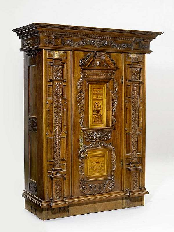 AN INLAID AND CARVED SINGLE-DOOR WALNUT CUPBOARD,