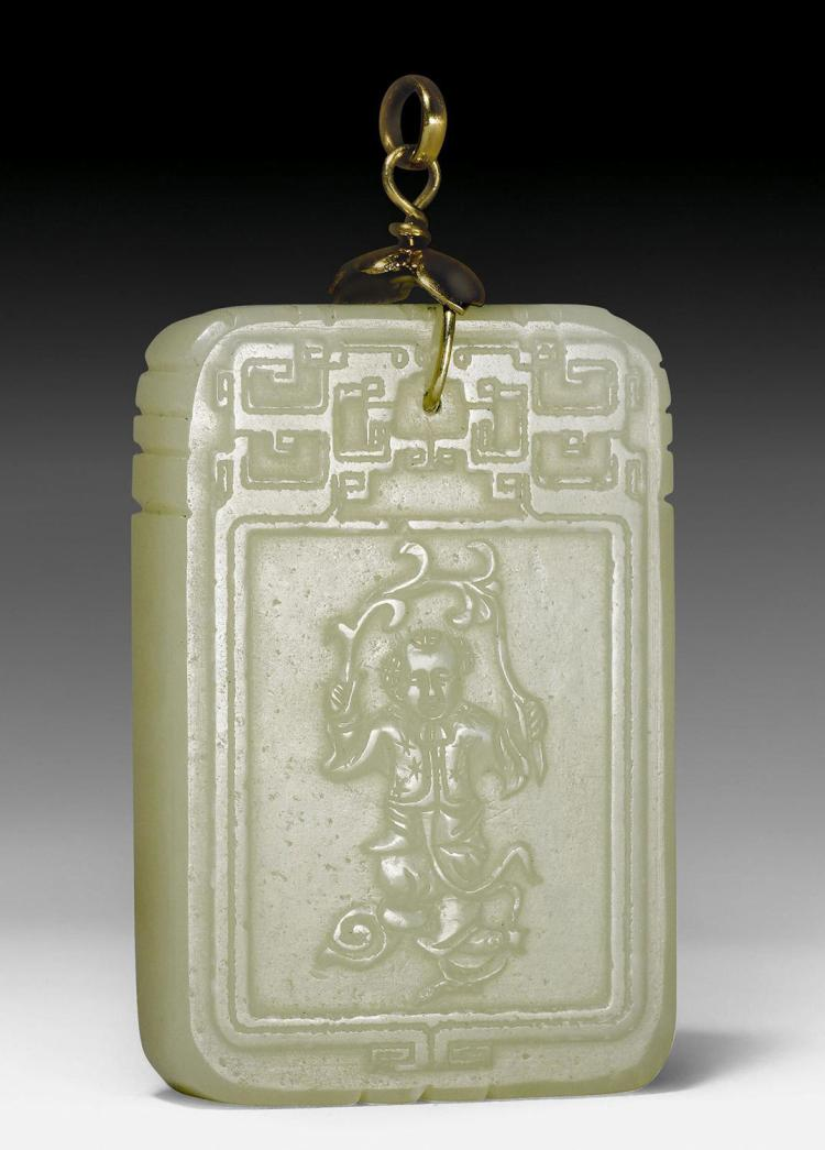 A rectangular pale celadon jade plaque with carved relief de