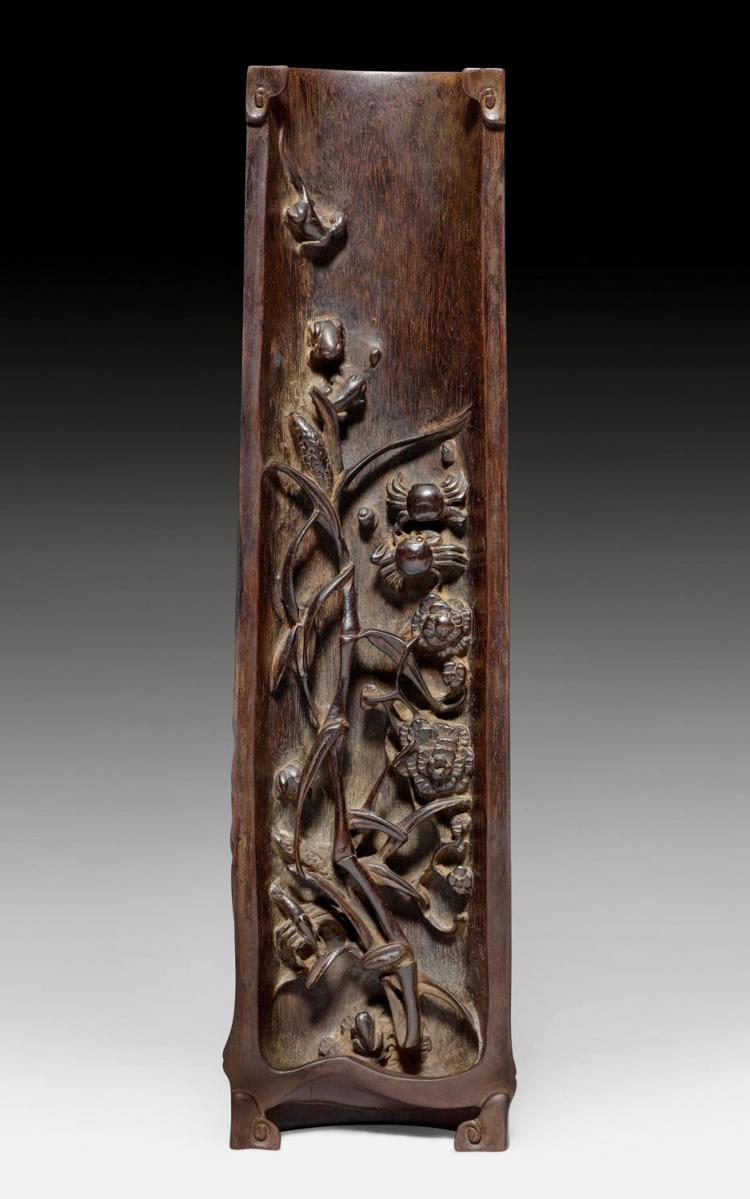 A fine wrist rest of zitan wood carved with animals and plan