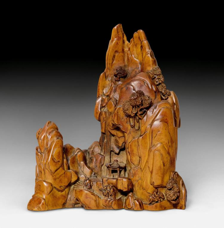 A carved boxwood sculpture of miniature mountain landscape