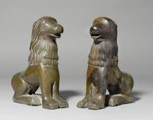 PAIR OF LION FIGURES (SUPPORTS FOR A BAPTISMAL FONT),