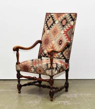 ELM ARMCHAIR,late Louis XIII, France, 19th century. With geometric patterned fabric cover.