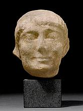 HEAD OF A YOUNG MAN, in the archaic Ionian style,