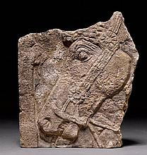 RELIEF FRAGMENT OF THE HEAD OF A HORSE,