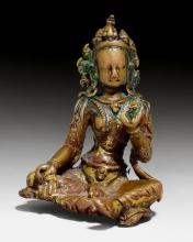 A SWEET COPPER ALLOY FIGURE OF THE GREEN TARA WITH REMAINS OF GILDING.