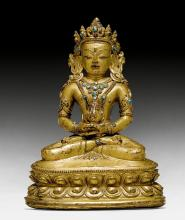 A GILT COPPER ALLOY FIGURE OF AMITAYUS WITH TURQUOISE INLAYS.