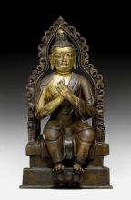 A PARTLY GILT COPPER ALLOY FIGURE OF BUDDHA MAITREYA IN EUROPEAN POSTURE.