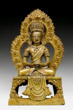 A PARTLY GILT COPPER ALLOY FIGURE OF AMITAYUS WITH AN AUREOLE.