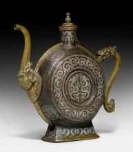 A FINE SILVER DAMASCENED IRON BEER JUG WITH BRONZE HANDLE AND SPOUT.