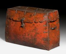 A RED PAINTED LEATHER CHEST.