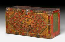 A WOODEN MONASTERY CHEST RICHLY PAINTED OVER PASTIGLIA.