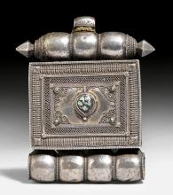 A LARGE SILVER AMULET BOX SET WITH FILIGREE AND LITTLE TURQUOISES.