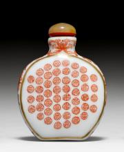 A MOONFLASK-SHAPED PORCELAIN SNUFF BOTTLE DECORATED WITH SHOU-CHARACTERS IN IRON-RED AND GOLD.