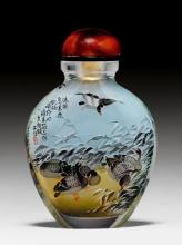 AN OVOID INSIDE PAINTED GLASS SNUFF BOTTLE DECORATED WITH GEESE.