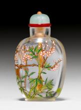 AN TRANSPARENT GLASS SNUFF BOTTLE ENAMELLED WITH THE