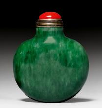 A MOONFLASK-SHAPED SPECKLED SPINACH-GREEN JADE SNUFF BOTTLE.