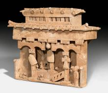 A POTTERY MODEL OF A MONITOR-ROOFED HOUSE WITH HUMAN FIGURES AND ANIMALS.