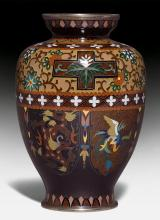 A SMALL CLOISONNE ENAMEL VASE DECORATED WITH PHOENIX AND DRAGON ON A DARKBROWN GROUND.