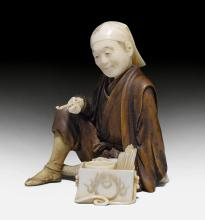 AN IVORY AND BOXWOOD OKIMONO OF AN INCENSE VENDOR.